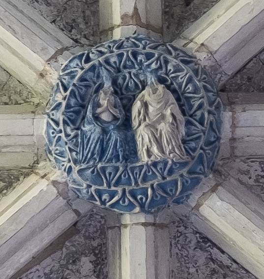 The Coronation Boss in the centre of the roof over the north porch chapel. Iconoclasts have sadly smashed the faces of the figures.