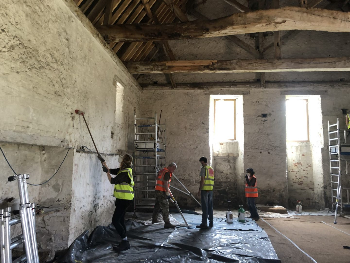 Lime washing the inside of the Hospitium at Boxley Abbey