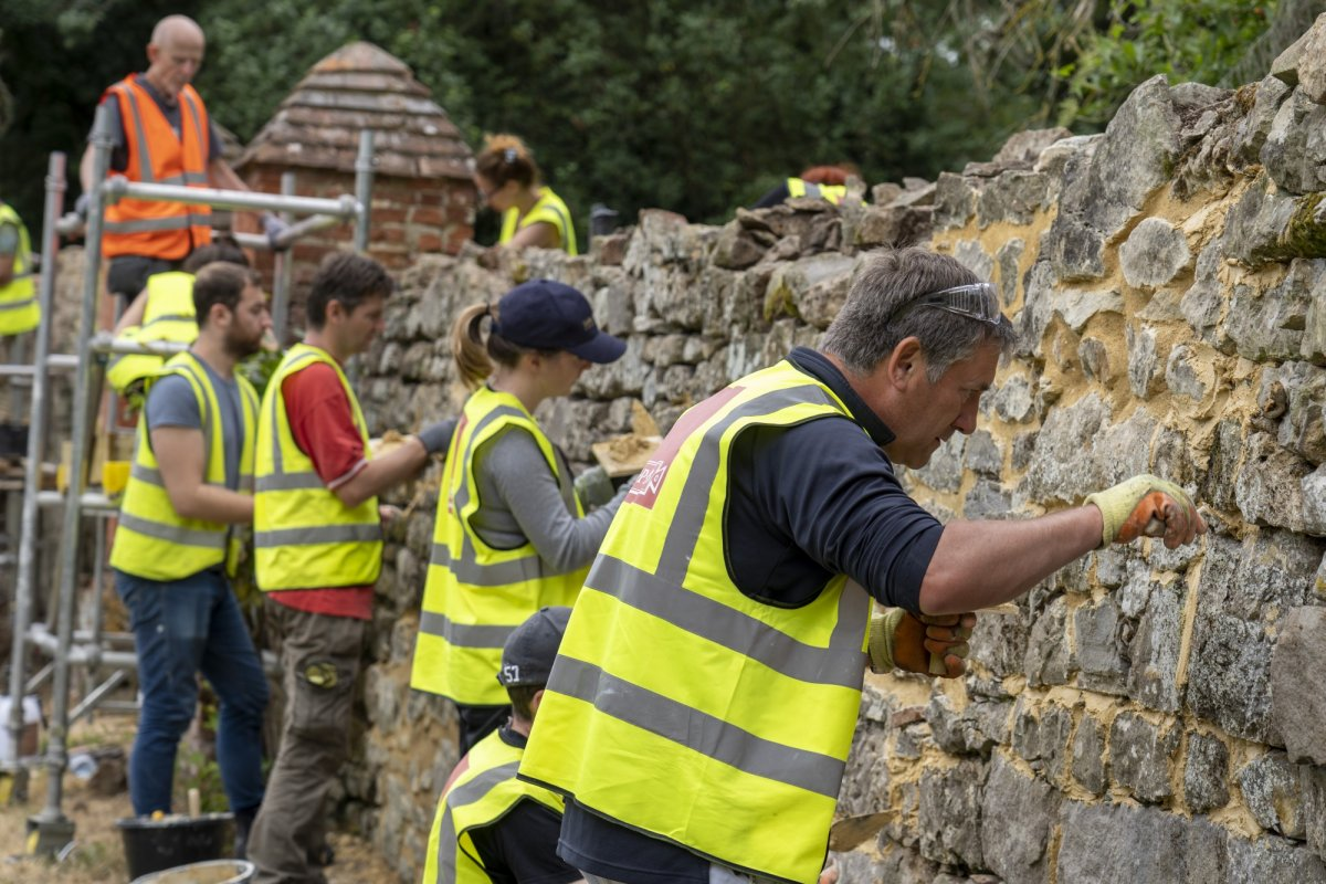 Repointing an old stone wall at the 2019 SPAB working party