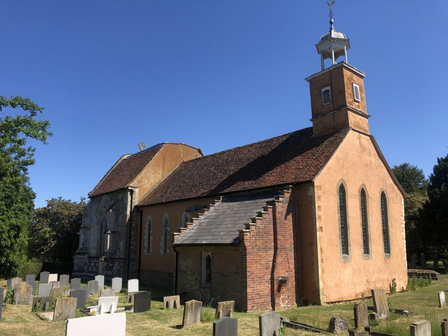 Tilty church viewed from the north west. The thin lancet windows are elegant but much more plain compared to the decorated east end