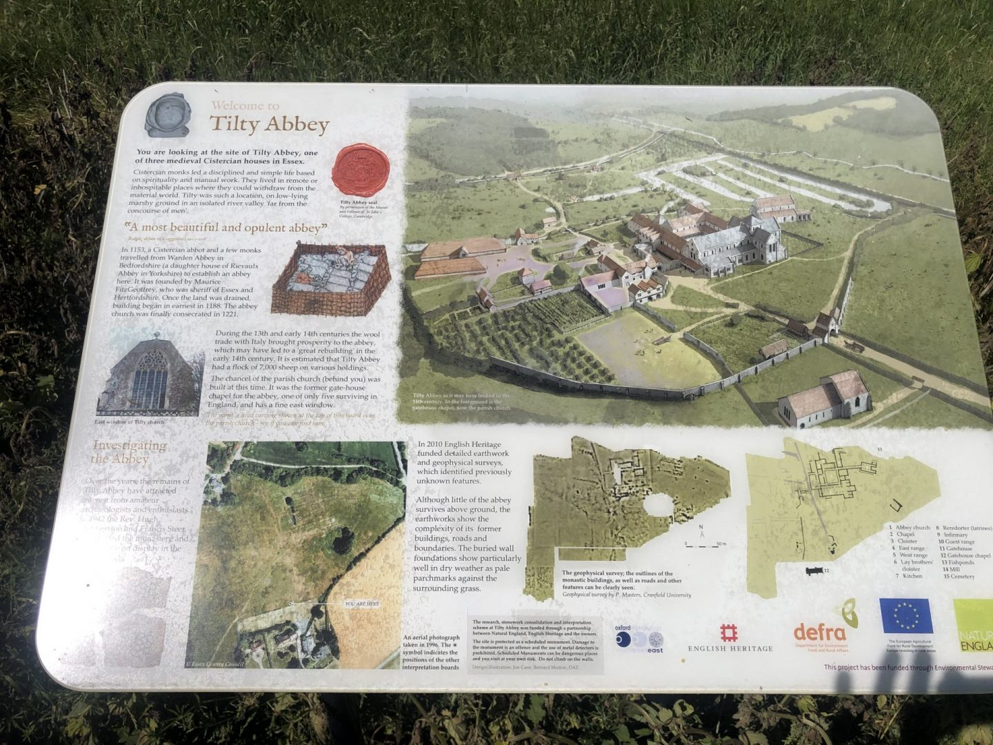 Interpretation panel at Tilty Abbey explaining the earth works, archaeology and what it would have looked like.